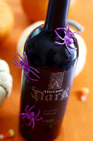 gift glitter spider wine bottle with purple glitter spiders made from simple craft materials