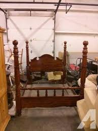 Queen-Size 4-post Bed Frame (Wooden head/footboards with steel rails)