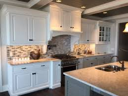 solid surface countertop with mixed tile backsplash in kitchen