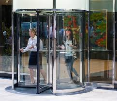 389 going through a revolving door without having to push