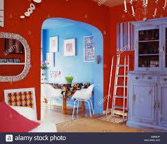 Red And Blue Living Room Steel Step Ladder Beside Painted Blue Dresser In Red Living Room