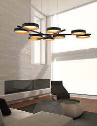 floating within an aluminum ring an led source edge lights a light guide disk that redirects its luminance to its upper and lower surfaces