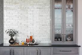 gray butler pantry with seeded glass cabinet doors