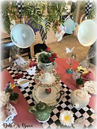 alice in wonderland table teacup chandelier overhead
