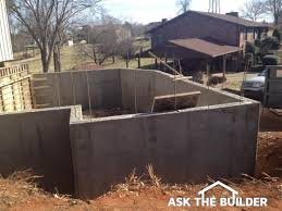 poured concrete vs block walls