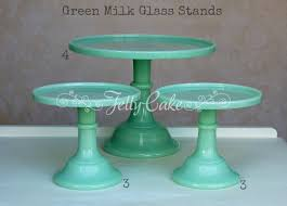 pink milk glass stands green milk glass labelled