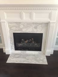 calacatta gold marble fire place