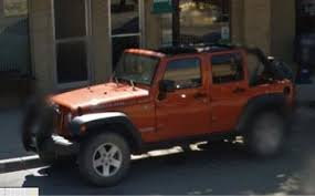 while out west a short stop in buffalo wyoming yielded this burnt orange jk unlimited rubicon parked outside of some random business possibly a bank