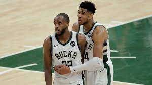Bucks' Khris Middleton takes center ...
