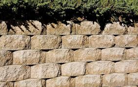 selecting the right material such as concrete blocks is the first step in building a retaining wall