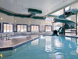 indoor pool and hot tub with a slide. Ramada Cochrane: Indoor Pool, Hot Tub And Water Slide Pool With A