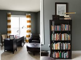 gray walls with brown furniture. dark gray walls white trim and carpet brown furniture hints of yellow with