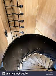 Angled Light Fitting White Oak Veneer And Black Steel Spiral Staircase The