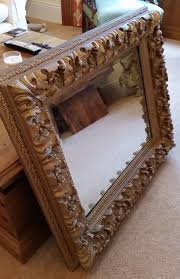 antique mirror extremely heavy item with ornate carved frame