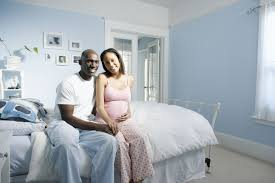 Lovely Couple In Bed Lying In Bedroom Photos Of Six Weeks Pregnant