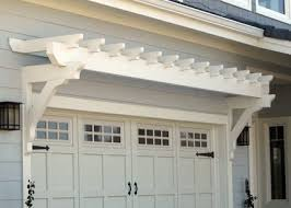 adding the arbor over the garage with hardware on the doors is easy to do in sing the outside of a house i have remended these kind of