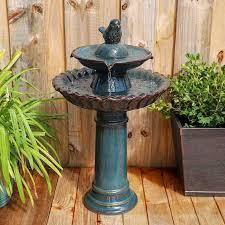 teal blue ceramic bird garden fountain