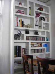 Kara & Giacomo: Display / bookshelves eclectic-living-room