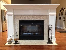 cream herringbone stone mosaic fireplace surround and hearth
