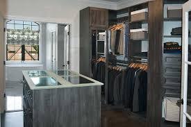 walk through closet with view of master bathroom