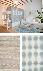 define zones in a studio or open concept space as seen above area rugs are a great way to create divisions between diffe areas when you must use a