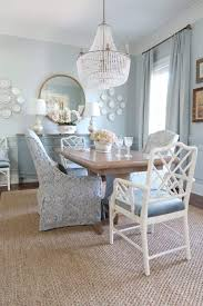 dining room at an angle with empire chanedlier in gold empire chandelier over round dining table