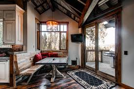 dazzling artcraft lighting in dining room rustic with reclaimed corrugated metal backsplash next to tv in kitchen alongside iron balcony grill and cat door