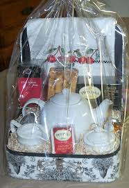 a tea themed gift basket with a hand sched tea towel and orange almond choco