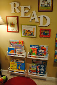 e racks from ikea used to hold the books i am definitely doing this in my future child s room