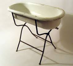 makes a great planter great for parties stand folds up also for displaying items in your height of tub on stand is 28