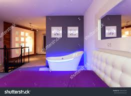 Neon Bedroom Bathtub In A Modern Purple Bedroom Neon Light Stock Photo