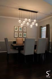 dining room green curtains blue glass chandelier high back dining chairs black rectangle dining table sugar