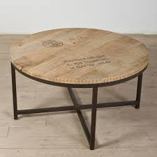 simple industrial made distressed round coffee table iron forged legs reclaimed wooden veneer