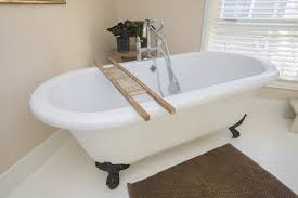 small clawfoot tub. A Simple And Crisp Bathroom, Featuring Clawfoot Tube Upon White Tile Floor. Small Tub