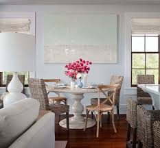 summer house id beachy dining room design with pale blue walls paint color canvas art marble pedestal round dining table french x back cafe chairs