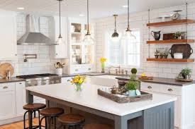 in terms of style white cabinets are the dominant look in the kitchen along with wood tables and of course the a front or farmer sink