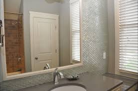 white glass mini bathroom wall tiles with large mirror and white door