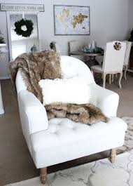 tufted chair with fur blanket