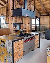 Barn house kitchen design with reclaimed wood cabinets and walls and  cabinets