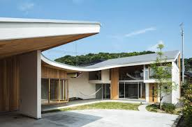 green eco office building interiors natural light. A Gentle Blanket-like Roof Covers The Daylit Interiors Of This Family House In Japan Green Eco Office Building Natural Light L