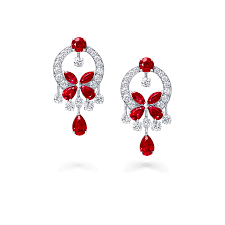 a pair of graff classic erfly chandelier earrings featuring a ruby erfly set with a diamond
