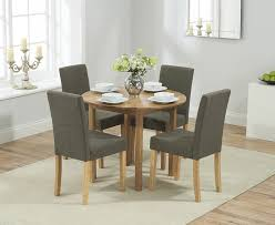 promo solid oak round extending dining table 4 maiya brown fabric chairs me home furnishings