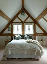 cathedral ceiling bedroom with very low design and exposed wooden beams stripes window curtain bed without