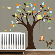 bedroom creative nursery wall decals jungle theme with brown tree and colorful leaf plus bird