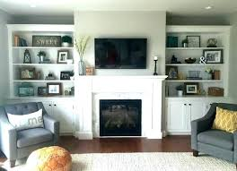 stone fireplace with built ins living around white