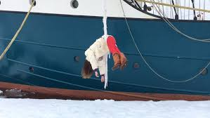 Anchored to a northern ice pack in the arctic, rigged off a tall ...