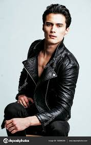 young handsome man in leather jacket stock photo
