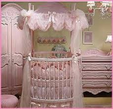 Only like the pink drape over bassinet