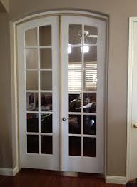 Interior Sliding French Door With Arched Top And Simple Handle