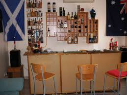 natural ash wooden home bar mixed with floating glass door cabinet storage and natural ash